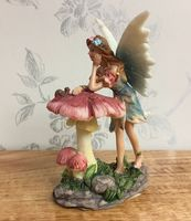 Flower Fairy Figurine Resting on Toadstool ~ Blue Dress
